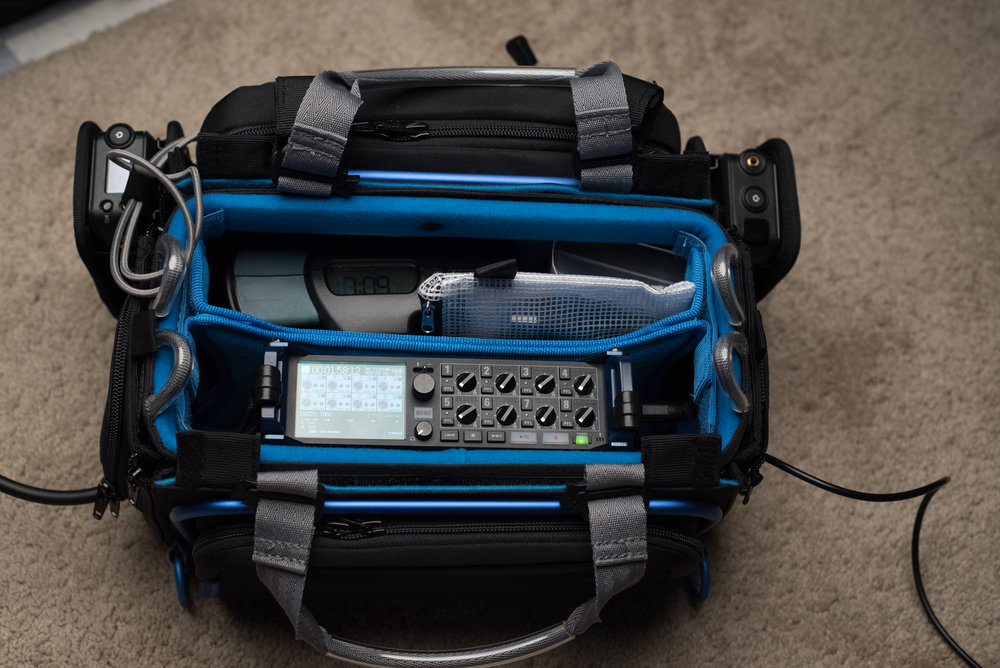 Orca OR-30 Sound Bag and Zoom F8 Recorder. Note the Anton Bauer Digital 90 battery, Sanken COS-11D case, and Tentacle Sync pouch to illustrate what you can fit in the other side of the bag if you put your wireless receivers in the two external pockets.