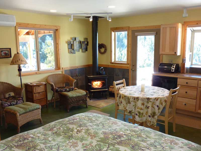 Interior of cozy suite for two. Links to Accommodations.