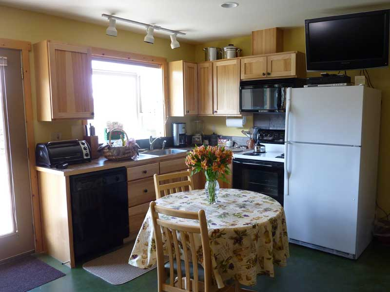 Full kitchen with dining table for two.