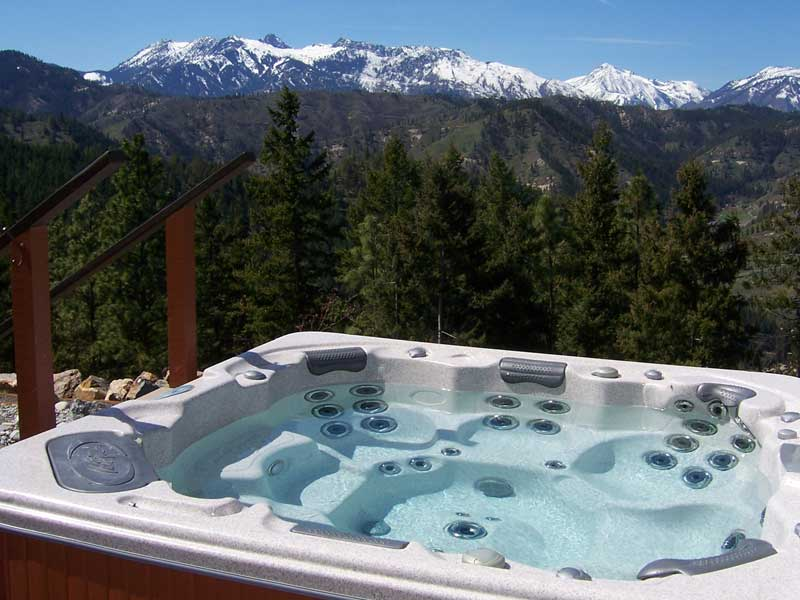 Outdoor hot tub with a view of the mountains.