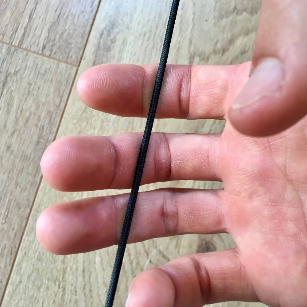 This is a deep finger hook. The string is placed behind the joint on all the fingers. This hook will feel the strongest but may not be the most suitable on lighter draw-weight.