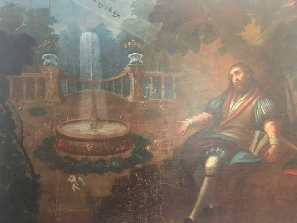 This painting is in the old Convent of Santa Monica in Puebla, it depicts Saint Augustus hearing the words  tolle lege , which means  take up and read .