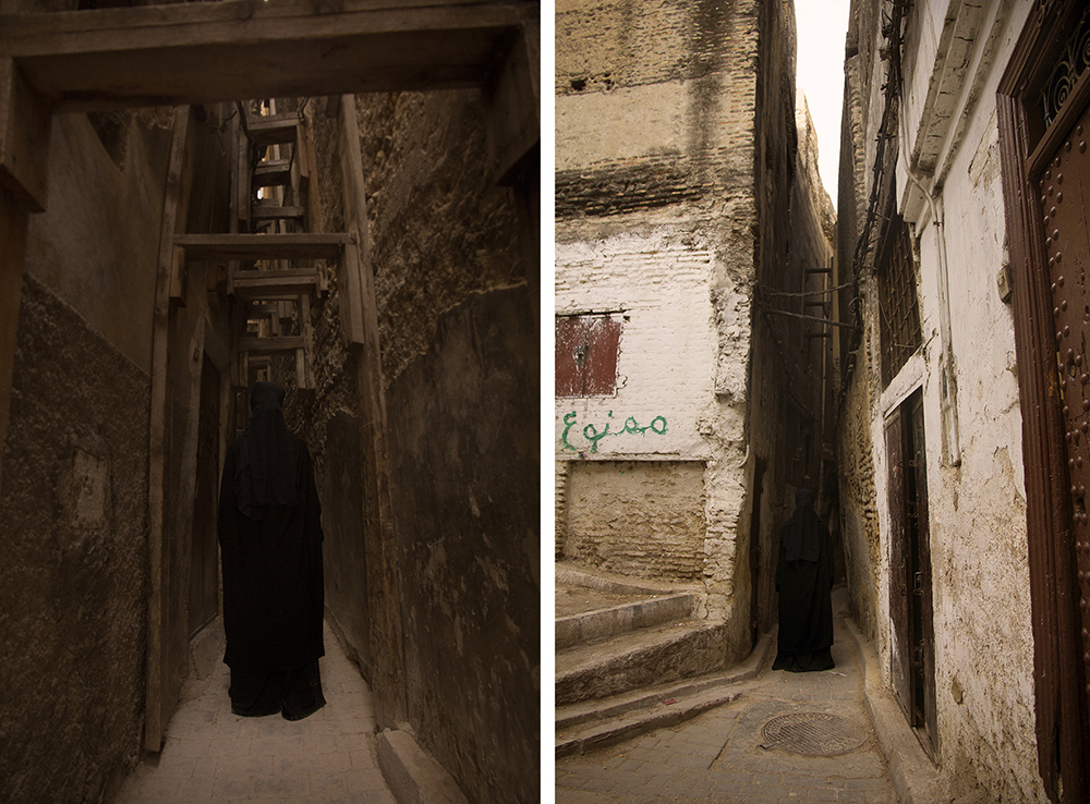 "Mohamed Thara,  FLAGRA : A series of Photographic prints, 2017  We follow Mohamed Thara as he journeys in the alleys of the old Fez Medina. He questions the city's manufacture throughout time and space and carries a singular and independent glance on the urban places, revealing their specificity, their morphology and their history. Through an important work process built across repetitive daily observation in the deepest part of the medina's main area, Mohamed revisits the complex relationships between the photographic medium and the public place. The marks transcribed whilst walking become the photographic prints. Moving through enables the restitution of the silhouette's hybrid identity and of the alleys traveled by and questions our relationship to urban space.  The 'Flagra' photographic series shows, first of all, an attempt to capture light, time and emptiness, the latter being one of the fundamental elements of photography. Mohamed Thara is fascinated by the 'Chiaroscuro' (light-dark) technic and by the delicate and precarious balance of shadows and lights, comparable to that of silence. Between presence and absence, these ambiguous and mysterious prints, question the identity of labyrinth-like and confrontational stratified space with formal restrictions by using narrow lanes and closed doors in near-darkness. Like a specter or a ghost, the presence of the faceless woman's silhouette wearing the niqab, in black, is identifiable according to the space that surrounds her whilst she moves amidst the Medina. Those images express a tremendous force of 'anamnestic spectrality', terms used by Derrida. The specter of the woman without a face is a form of deliberate and permanent disguise of identity generated by the concealment of the face. This concealment erases a woman's body from ordinary visibility by imposing on her a visibility of negation, the dark and obscure trace of her being erased. A human being is defined by his/her face"" says Emmanuel Levinas. Every child, every man, every woman identifies 'himself/herself', in what he/she offers as most original, his/her face.  It is above all on the face that 'self' appears. Living as a human being is about playing the game of face's swapping. Even better: the capacity of exchanging faces, forms humanity as a community. We show our faces in order to be recognized by others as belonging to the human family. The ""I"" and the ""you"" are born out of the faces' dialogue, the founding dialogue that precedes the verbal one. Mohamed Thara sees the burqa as well as the niqab as ways of subtracting the face from the visibility, to erase it. A coffin of tissues that destroys in the woman it buries, the right to belong to the human community insofar as it prohibits her from entering the sphere of dialogue.  In the 'Flagra' series, public space is a playground subjected to the representations of identity that direct the forms of appropriation and the general perception that is made of it. Images contain very important argumentative possibilities in a world where they are made free to be seen. Flagra is a series that transcends social and historical boundaries in order to form a symbolic and iconographic testimony on social changes and on the Islamic radicalization of people present in Morocco Fez Medina.  Par  Mohammed Hamdouni, Le Journal Liberation,  Casablanca, Maroc, 07.10.2016  https://www.libe.ma/Photographie-Dans-le-ventre-de-la-Medina_a78436.html"