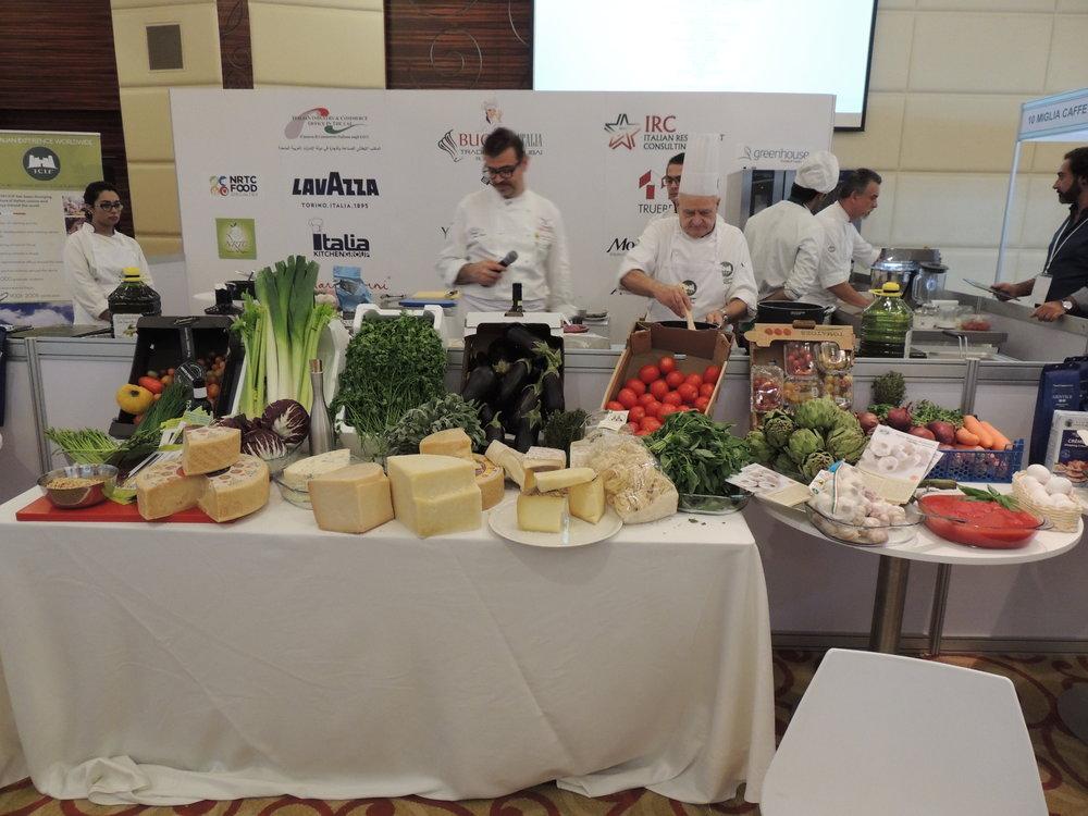 In foto: Kitchen Corner interno a BuonaItalia Trade Show. Protagonisti delle masterclasses culinarie, i due Chef di ICIF: Chef Mario Sobbia e Chef Fausto Meli.