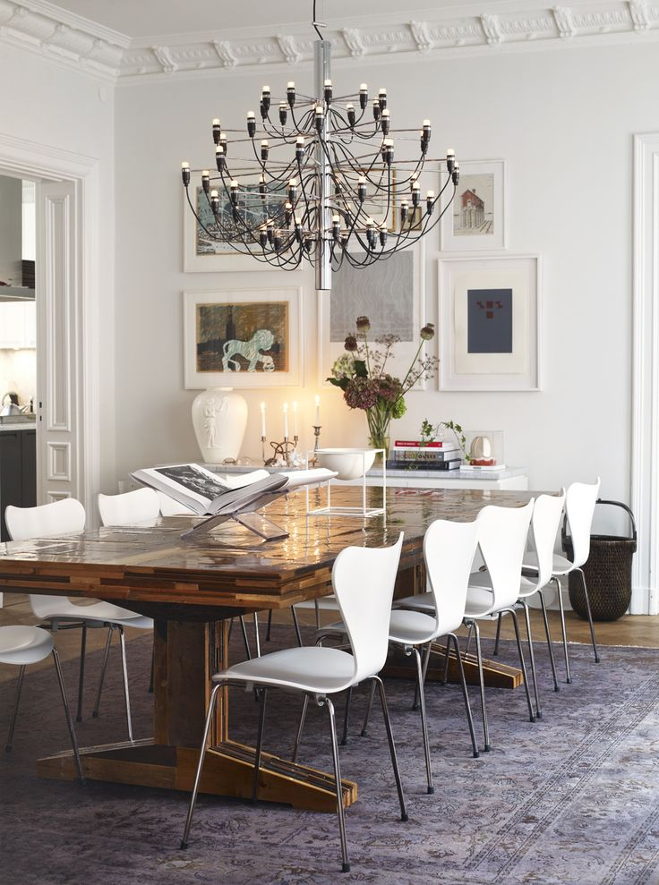 The Chandelier and Dining Chairs are both Mid Century Design Originals in this elegant home in Stockholm.