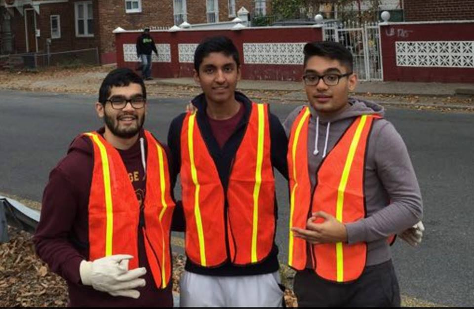 Brothers Rushabh, Arjun and Jay volunteering at a Adopt a Highway cleanup site.