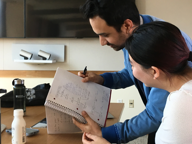 Team members Arjun Bisen and Carissa Chen run through a user flow