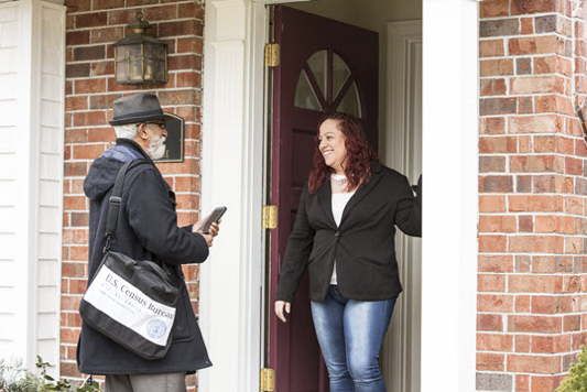 A census enumerator and a respondent during a census survey (source: U.S. Census website)