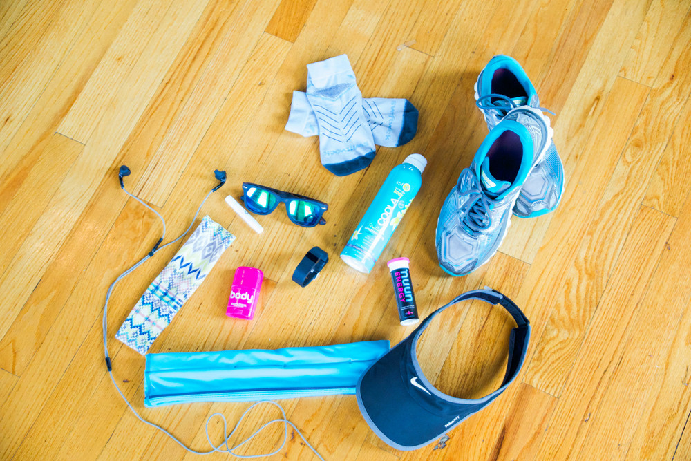 Yurbud headphones, Urban Halo headband, lip balm, sunnies, Swiftwick socks, SPF, Nuun Energy tablets, Brooks Glycerin shoe, Nike visor, running belt, antiperspirant deodorant, and a fitbit!