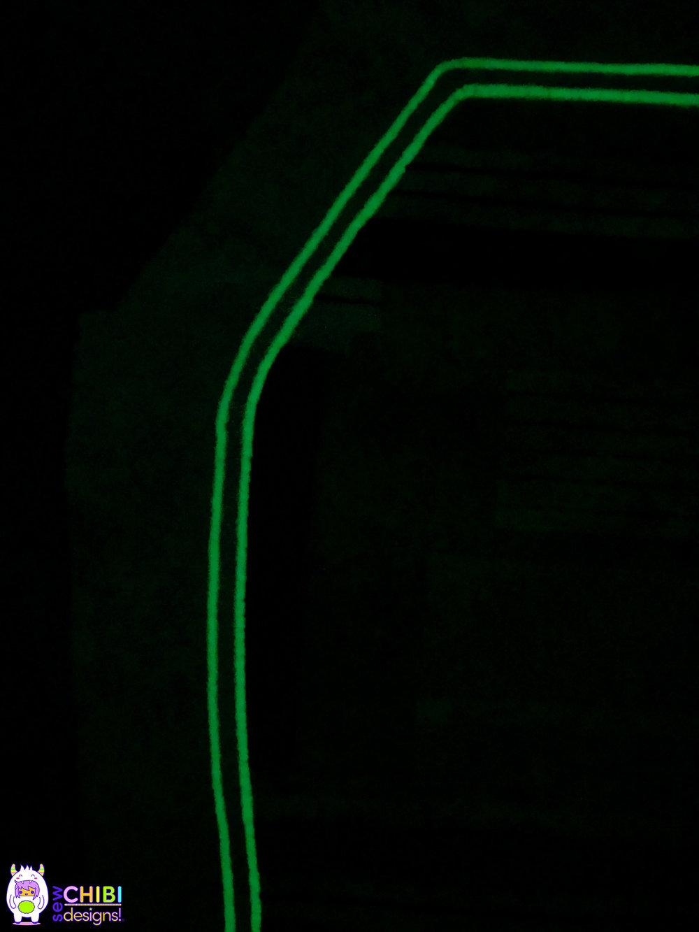 Glow in the Dark. - A close up of the glow-in-the-dark satin stitching using the specialty thread.