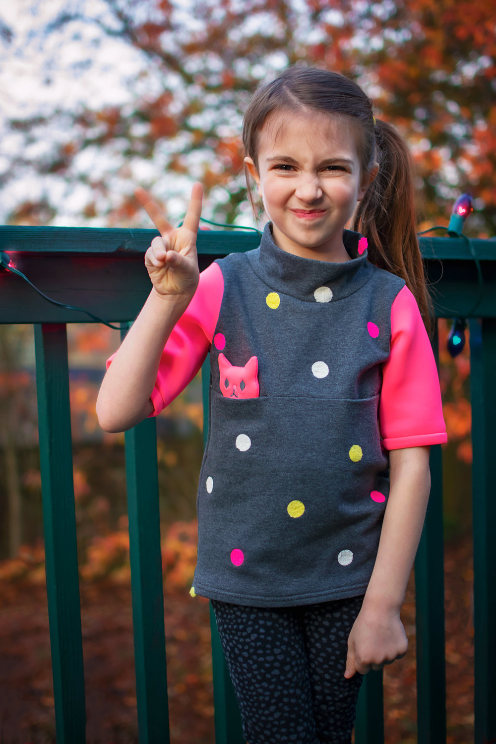 A festive Umaru Shirt PDF Pattern by Sew Chibi Designs for the Project Run & Play Holiday Tour! Kids and Teen fashion for winter 2018! Check out the sneaky kitty hiding in the Christmas tree! Click to buy your copy of the pattern!