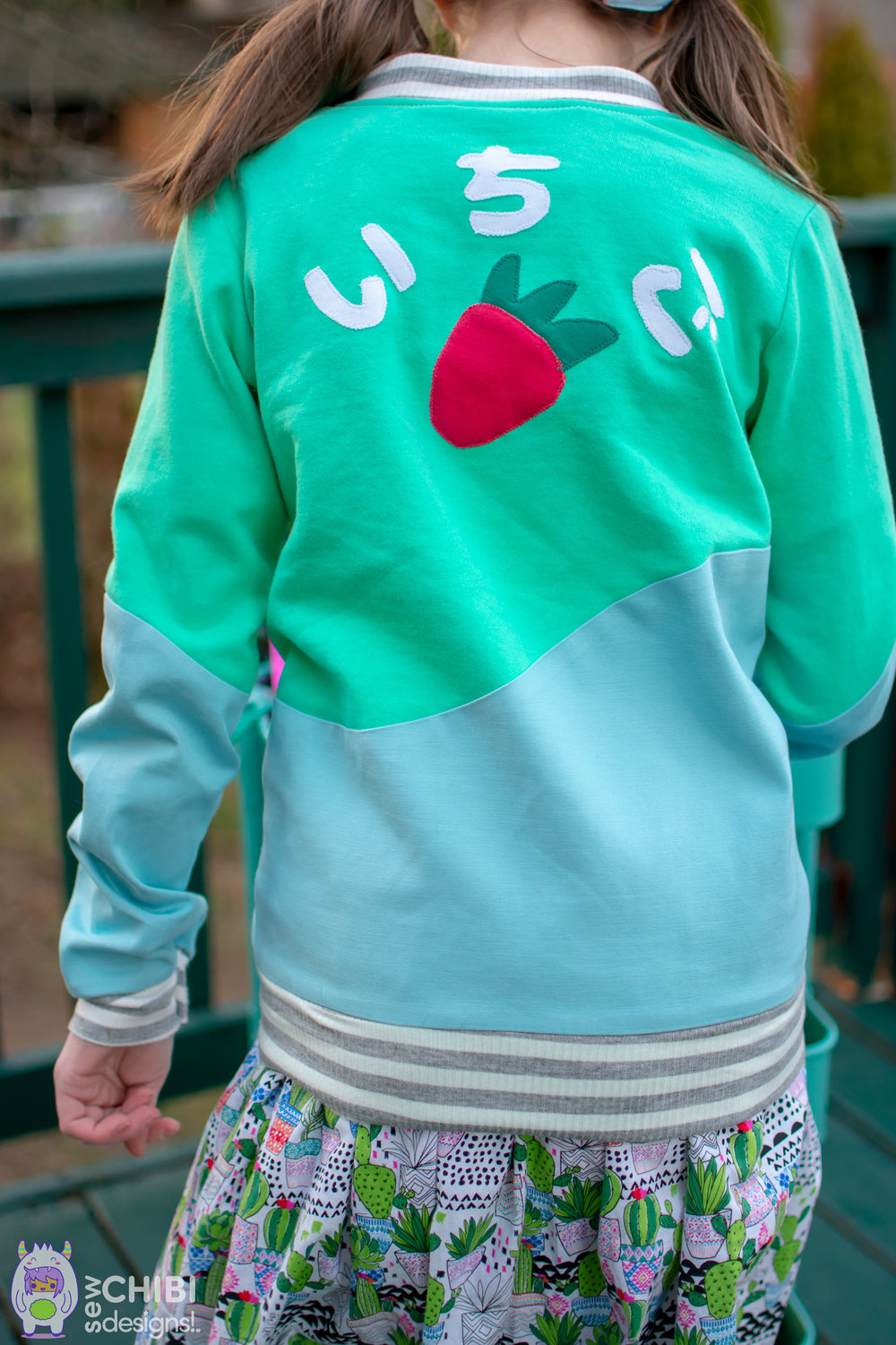 The Ichigo Bomber Jacket PDF Pattern by Sew Chibi Designs. A lightweight, color blocked, knit coat for all kids: boys and girls, from baby to teen! Perfect for spring! $9 USD