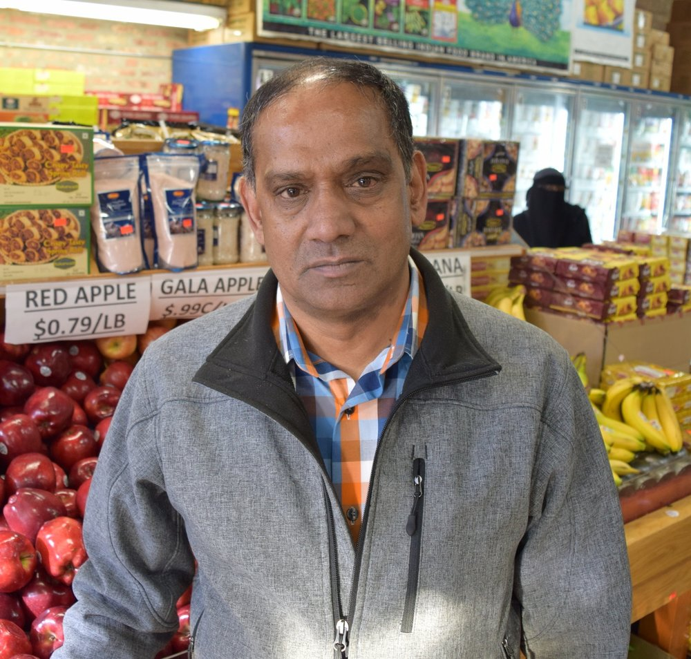 "Bobby Patel   Manager, Patel Brothers Grocery   ""This grocery store started in 1974.  This is a large Indian and Pakistani community here. Patel Brothers has been here a long time, and we are selling good quality groceries. That's why everyone likes the Patel Brothers.  People come from out of state, Indiana, Iowa, small suburbs…This area is a big market of Indians, Pakistanis, Iraqis…lots of mixing here in the community. We never have any problems."""