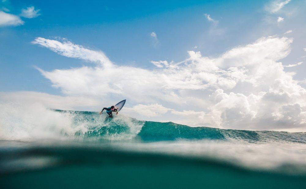 2/Surf along a black sand beach