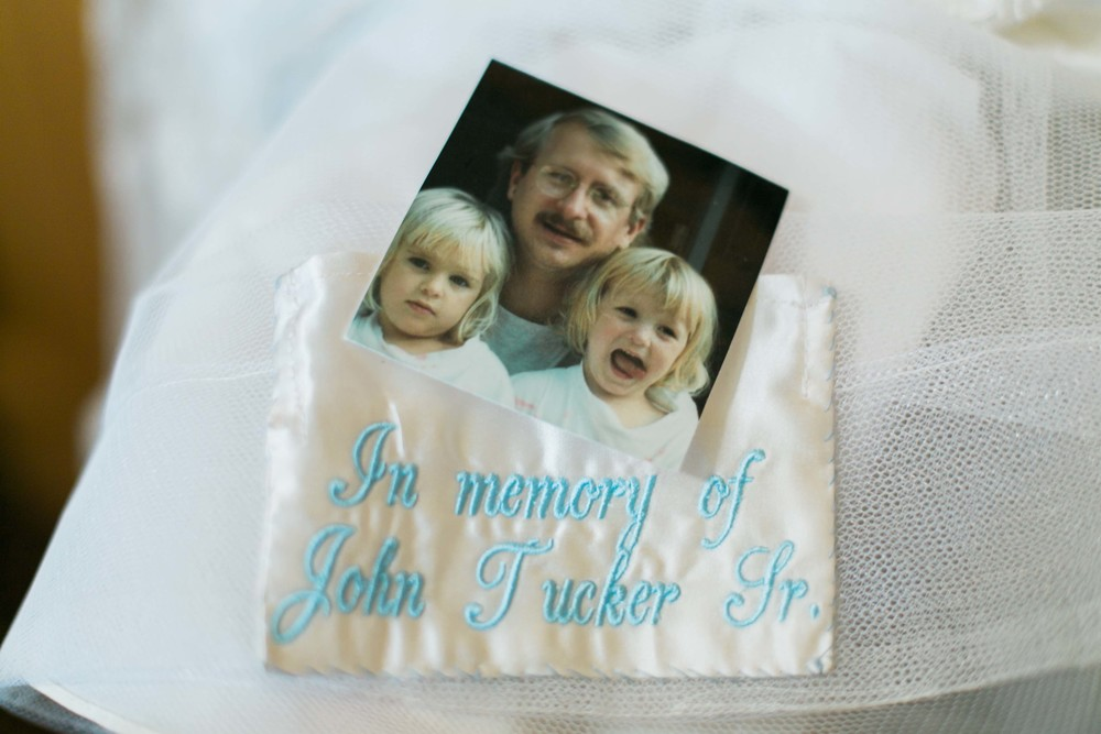 The embroidered satin patch was sewn into the lining of Leah's dress so that she could keep a picture of her dad with her throughout the day and as she walked down the aisle