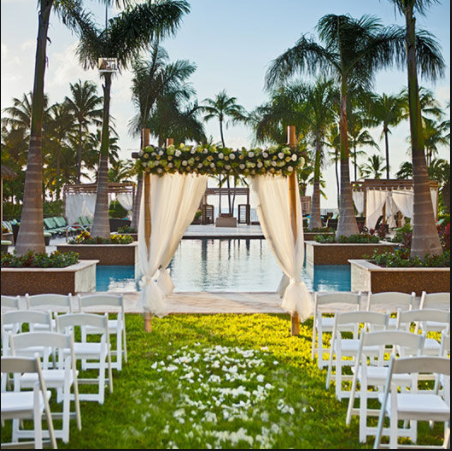 A destination wedding may be held in a tropical setting like the one shown above.