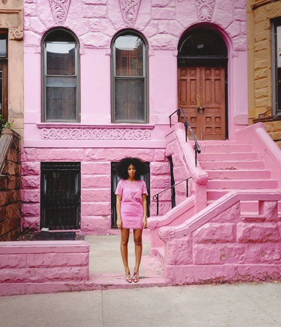 Solange in a cool, neon pink. Image via Eff Yeah Solange.