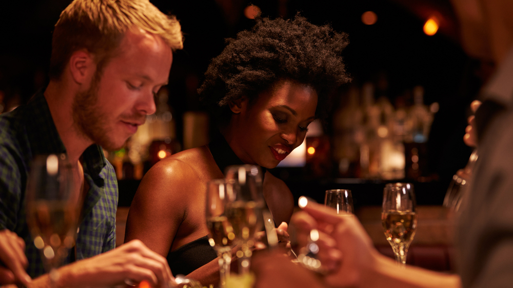 stock-photo-group-of-friends-enjoying-meal-in-restaurant-365582666.jpg