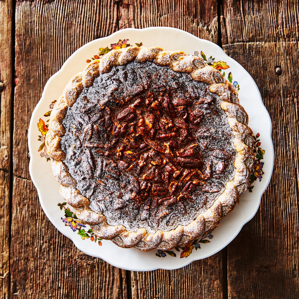 Chocolate Bourbon Pecan Pie - Roasted pecans and Tainori chocolate bound together with sugar cream and seasoned with vanilla bean and bourbon.Available in Small and Large.
