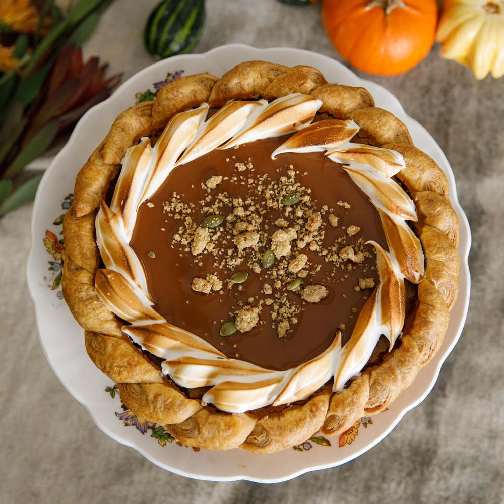 Pumpkin Pie - A classic American blend of autumn spices and a rich pumpkin custard with scorched meringue, caramel sauce, and a toasted pepita strüssel.Available in Small and Large.