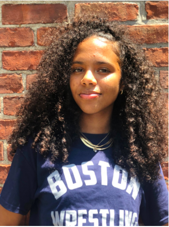 Ashily Lara Baez    Ashily is 16 and goes to John D. O' Bryant. Her goals for wrestling are to enhance her skills and learn new moves quicker. Ashliy's dream is to become an architect and an interior designer.
