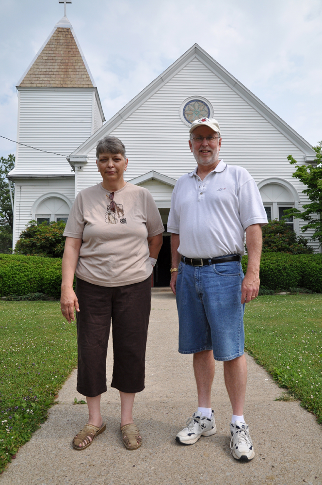 Janet McIntyre with Pastor W. Lee Dreyer at the White Oak Springs Presbyterian Church in Evans City.  The church is the focus of the water drive for families whose water is no longer usable.  © Brian Cohen/MSDP 2012