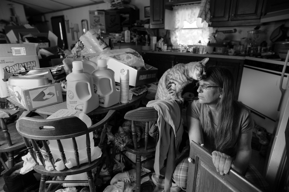 Deb Eck, a resident of Riverdale trailer park, lives in chaos during the transition between eviction and move. The land under Riverdale Trailer Park in JerseyShore, PA, was sold to Aqua America as the site for a water-extraction plant forMarcellus Shale gas drilling © Lynn Johnson/MSDP 2012