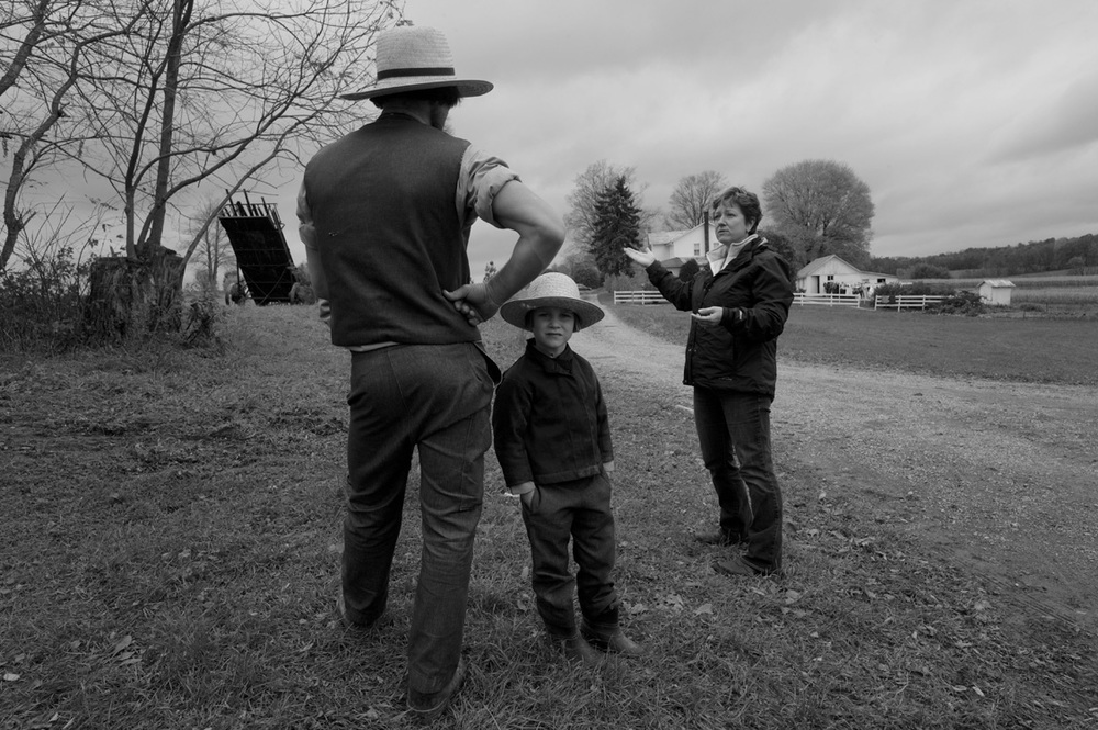 Carrie Hahn, an activist in New Wilmington area, talks to an Amish farmer about the hazards of allowing a gas drilling operation on his land.  © Lynn Johnson/MSDP 2012