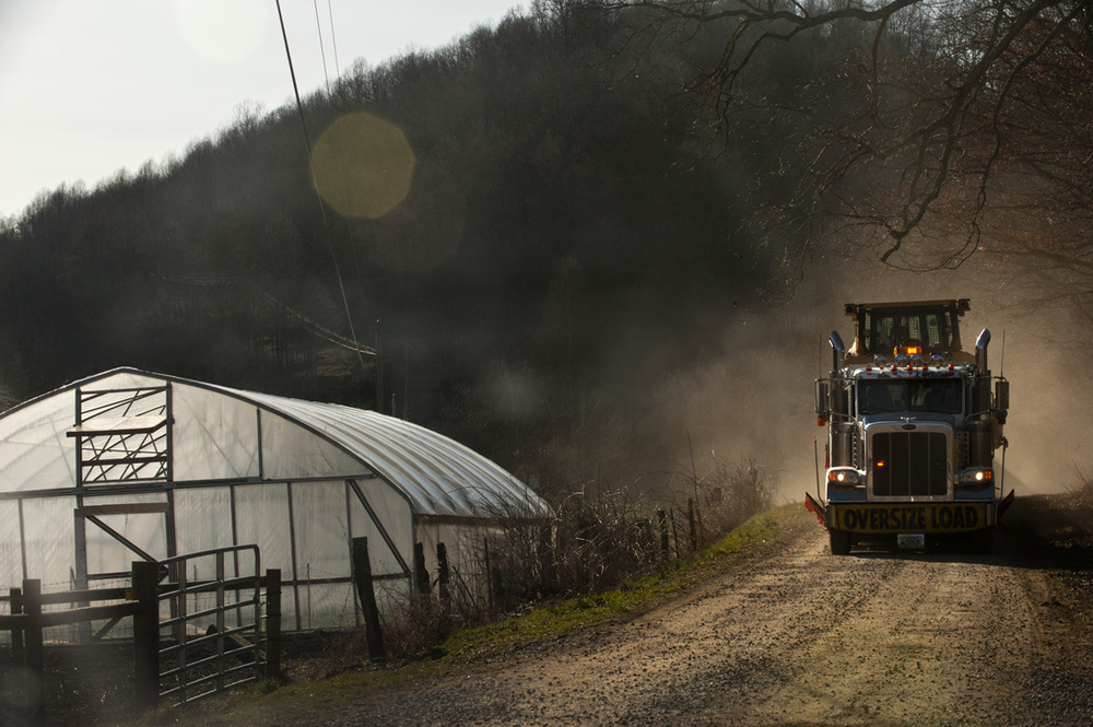 A large truck rumbles by the Williams' farm. Dust is another problem for landowners because of increased truck traffic on rural roads.  ©   Martha Rial/MSDP 2012