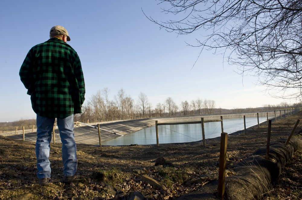 A landowner observes a freshwater impoundment built by EQT near the edge of his farm in Greene County.  ©   Martha Rial/MSDP 2012