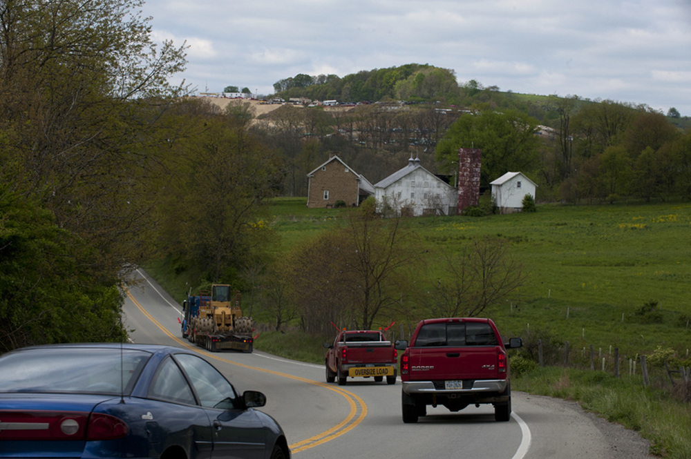 A truck hauling heavy equipment for the natural gas industry slows traffic along Route 188 in Jefferson Township, Greene County.  © Martha Rial/MSDP 2012