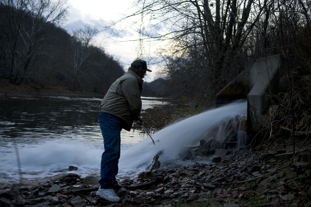 Ken Dufalla collects a water sample while monitoring bromide levels at Clyde Mine discharge along Ten Mile Creek in Greene County. In fresh water, elevated levels of bromide, a substance usually found in seawater, are always a result of human activity. Dufalla is president of the Harry Enstrom Chapter of Izaak Walton League in Greene County and a long time advocate for clean water. As of March 2012, high bromide concentrations- some contend as a result of Marcellus Shale activity- remained a concern in many of the region's rivers.  ©   Martha Rial/MSDP 2012