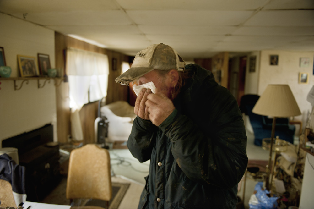"After workers hauled away two water tanks that supplied three homes from his backyard, John ""Denny"" Fair went inside his small home and became teary-eyed. When Fair reconnected his water well, it pumped out orange-brown water that he and the neighbors don't want to use. Fair said the water turned brown and ""stinky"" shortly after the fracking started.  © Scott Goldsmith/MSDP 2012"