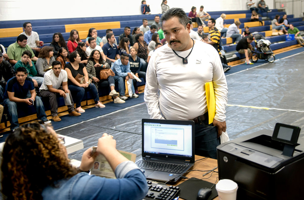 "Jose gets his Mexican passport renewed during the one-day service offered by the Mexican Consulate at Central Catholic High School in the Oakland neighborhood of Pittsburgh. The ""mobile consulate"" as it is called, provide consular ID, passport renewals and other services.  © Nate Guidry/TDW 2017"
