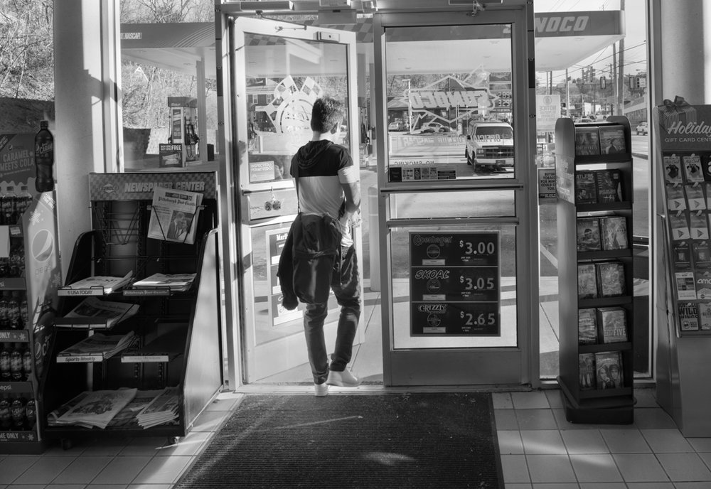 Som stops at a local gas station convenience store to buy cigarettes before going to work.  © Scott Goldsmith/TDW 2017