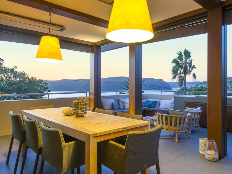 Huge indoor-outdoor terrace with the convenience of a built-in BBQ Kitchen plus under-cover dining table; electric louvre blinds provide sunlight control, and ceiling-mounted electric heaters add comfort in winter