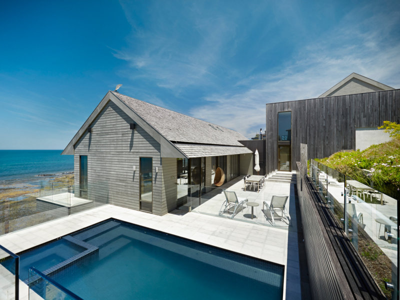 Extensive balconies provide front row seats to the scenic views; while a large central entertaining terrace is a natural sun trap and adjoins a glass-framed swimming pool and spa overlooking the Bay.