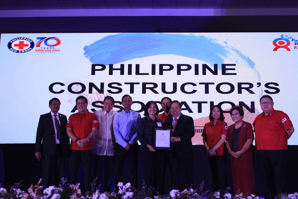 Represented by Ms. Bianca Martinez (5th from the left), the Philippine Constructors Association Inc., received a Siver Plaque of Appreciation straight from Philippine Red Cross Chairman Richard Gordon (7th from the left) and the PRC's board of governors.