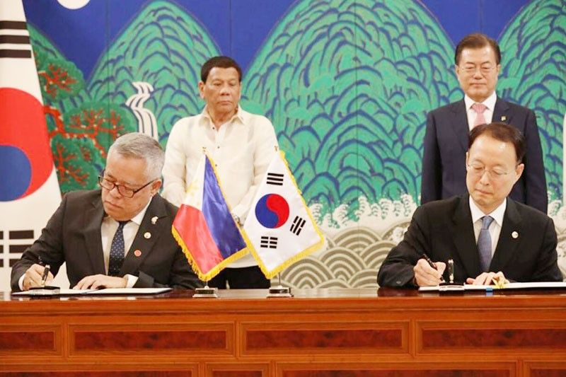 PHL-KOREA JOINT TRADE COMMISSION: Trade Secretary Ramon Lopez signs a memorandum of understanding with Republic of Korea Trade, Industry, and Energy Minister Ungyu Paik to establish a mutually beneficial and strategic trade and economic partnership between the two countries through a Joint Commission for Trade and Economic Cooperation. The JCETC will cover cooperation on the areas of trade and investment, industry and industrial technology, especially automobile as well as mold and die. The MOU signing was held in the presence of President Duterte and South Korean President Moon Jae-in during the bilateral meeting between the two governments on June 4. Read more at https://www.philstar.com/business/2018/06/08/1822485/korea-firms-eye-44-billion-investments-philippines-energy-projects#0iGiQ5qUKXgkC0I0.99