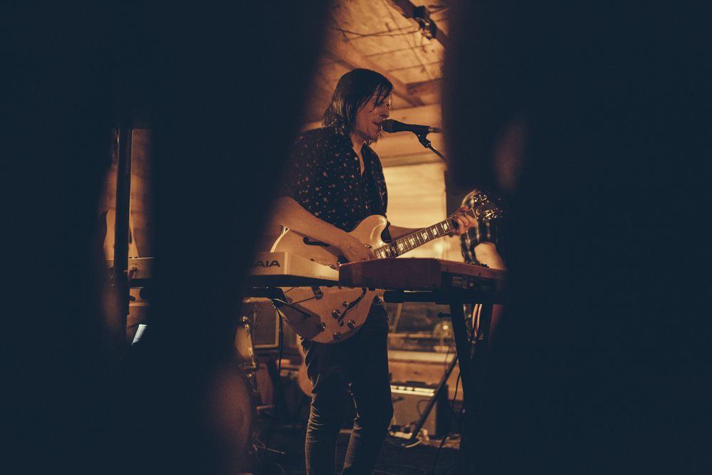 Ken Stringfellow, ripping Eric Pulido's guitar a new one. Photo by Marcus Junius Laws