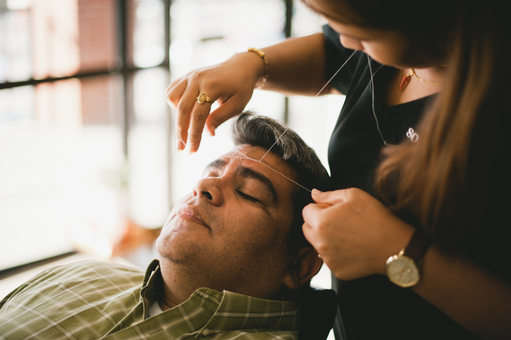Our lovely model, Narci, getting his eyebrows threaded. Photo by Shaina Sheaff