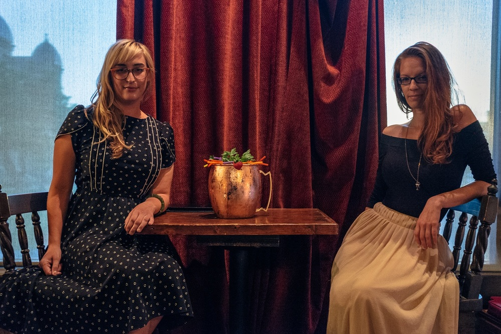 Co-Founders Sara & Shaina sitting next to the BIG version of The Dentonite at the relaunch party Tuesday night.  Photo by Brian Doore.