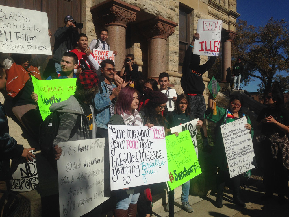 Protestors in downtown Denton. Photo by Jackie Thompson.