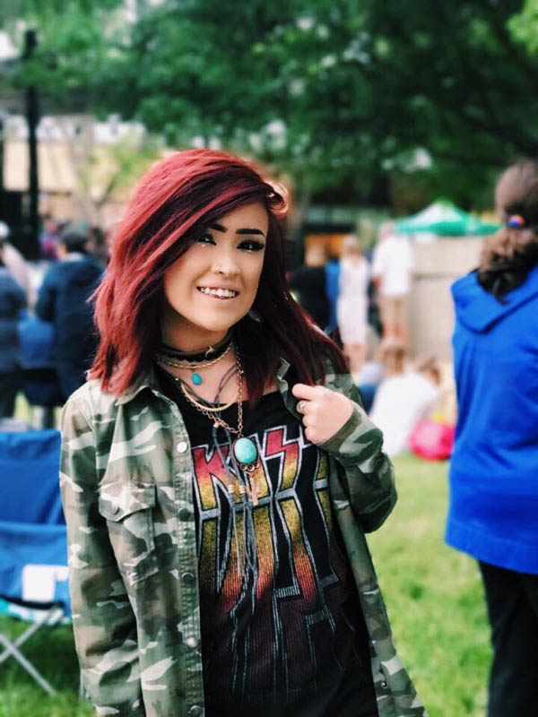 """Stephanie Martinez - Martinez threw together an outfit perfect for chilly weather, while still dressing up for Jazz Fest.""""I love dressing colorful with a lot of accessories because I feel like the art part of the festival is about all the cool accessories you can buy there,"""