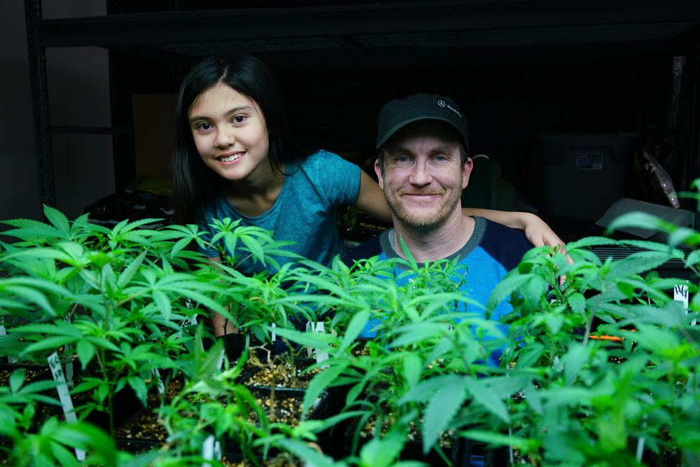 Alexis Bortell poses with Jason Cranford and the Haleigh's Hope plant. This is the strain Alexis's oil is made from, and Cranford is the man who makes it. Photo by Kristen Watson