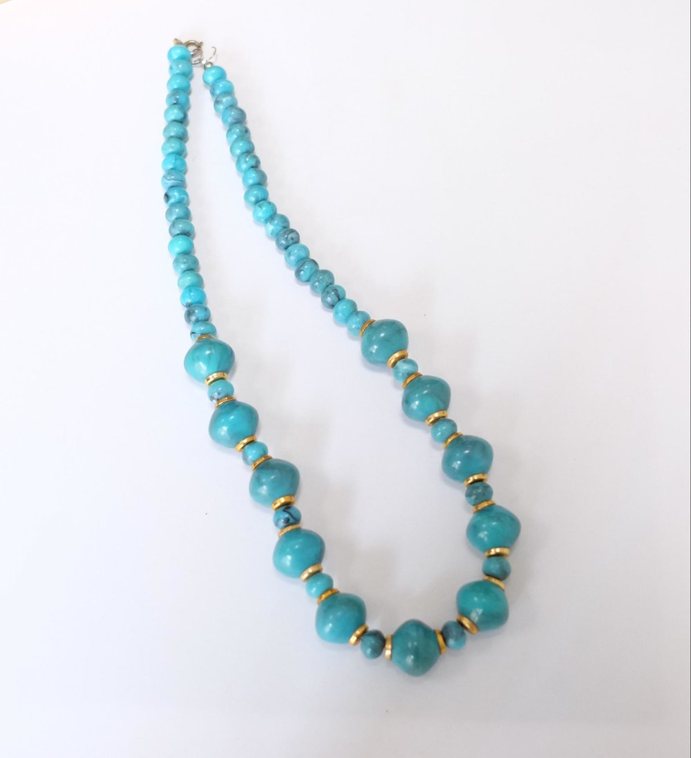 Vintage blue necklace. Regular wardrobe staple.