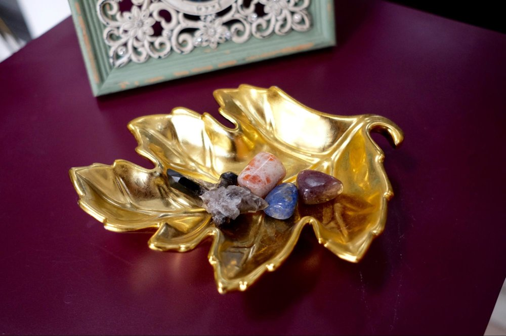 Gold leaf. Cradles my crystals and gemstones by my bedside.