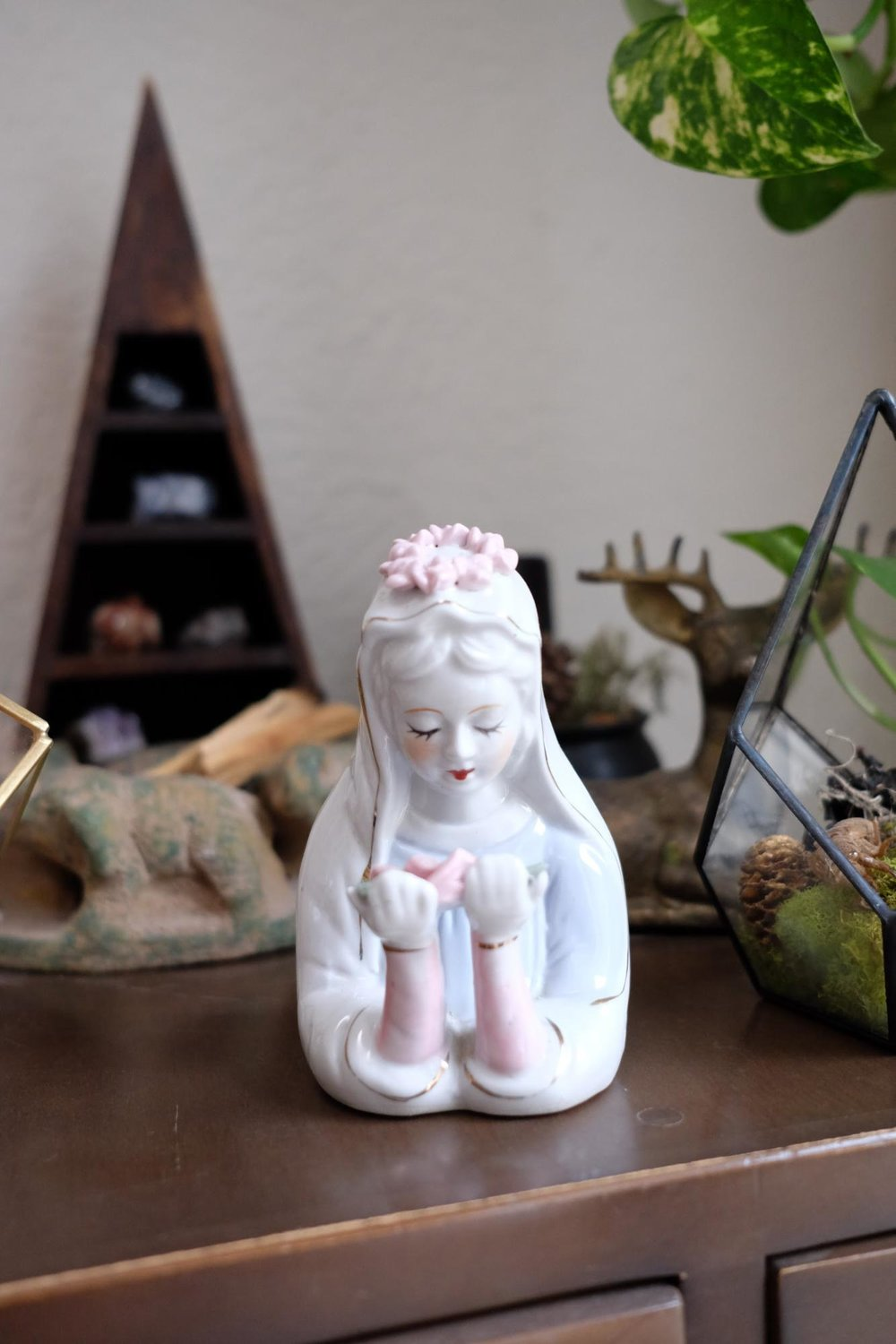 Virgin Mary figurine.