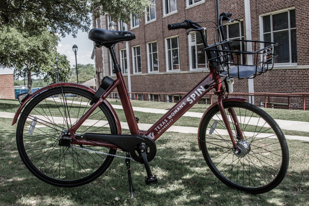 Students using Spin bikes will find they match TWU's maroon color scheme