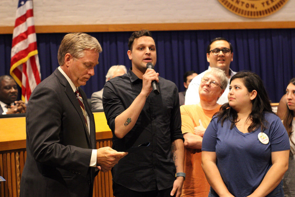 George Ferrie and Lesly Guiterrez accept the Pride Month Proclamation